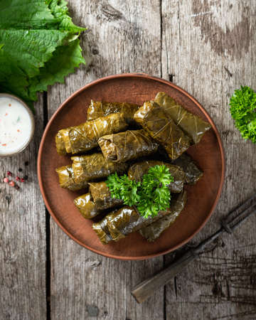 Dolma on a wooden rustic background. Traditional Caucasian, Turkish and Greek cuisine, top view Reklamní fotografie