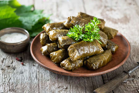 Dolma on a wooden rustic background. Traditional Caucasian, Turkish and Greek cuisine Reklamní fotografie - 154077023