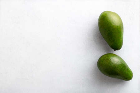 Two avocados on a white background, top view, copy space Reklamní fotografie - 154077053