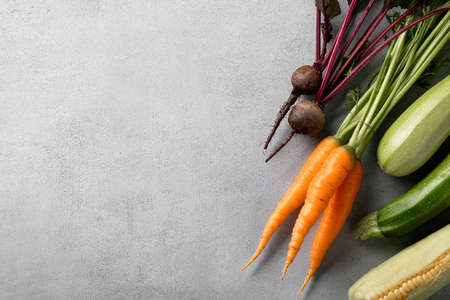 organic vegetables on light background, top view, copy space