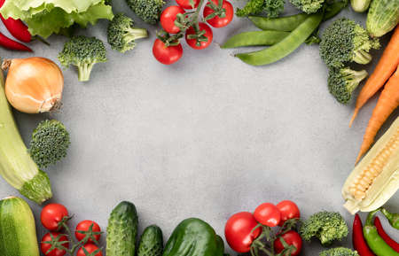 organic fresh vegetables on a on light background, top view, place for text Reklamní fotografie