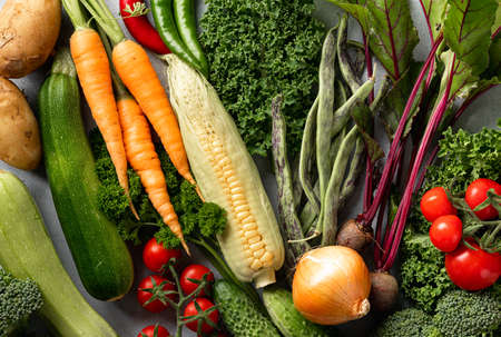 different fresh vegetables background, top view