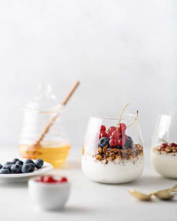 Breakfast, granola with yogurt and berries in a jar on a light background Reklamní fotografie - 153737217