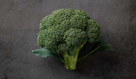 broccoli on black background, top view, copy space