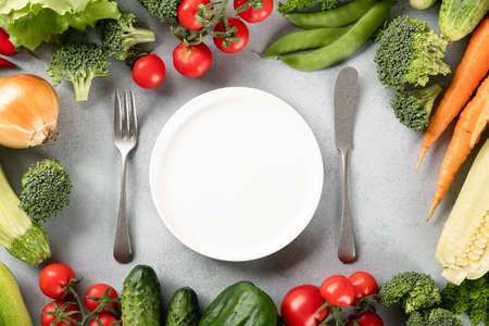 organic fresh vegetables on a on light background, top view, place for text Reklamní fotografie - 153737223