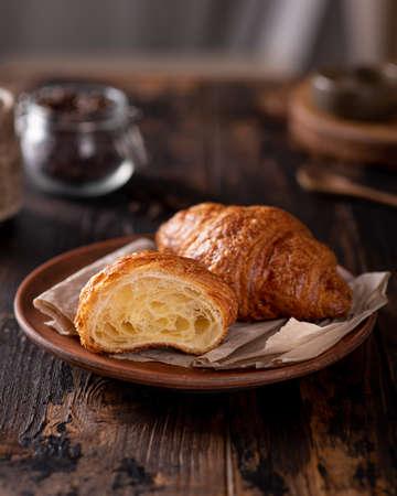 cut fresh croissants on a dark wooden background