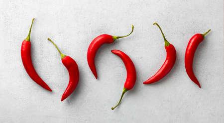 Red chili pepper on white Reklamní fotografie - 155092049