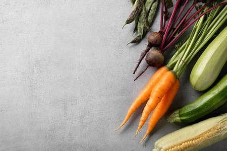 Organic farmer vegetables for cooking on grey Reklamní fotografie - 155092048