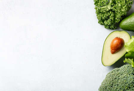 Detox dieting concept. Avocado, kale and broccoli on a white background, top view, border Reklamní fotografie - 154865132