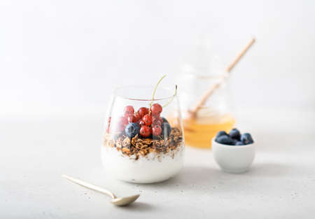 Breakfast, granola with yogurt and berries in a jar on a light background Reklamní fotografie - 154951456