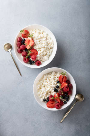 cottage cheese with fresh berries a light background, view from above Reklamní fotografie - 154952006