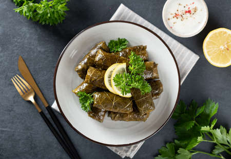 Dolma on a dark background. Traditional Caucasian, Turkish and Greek cuisine, top view Reklamní fotografie
