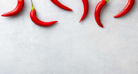 red chili pepper on white background, top view, copy space