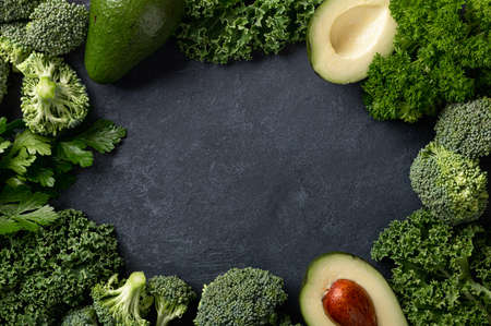 green vegetables on a dark stone background, top view, place for text Reklamní fotografie - 155183880