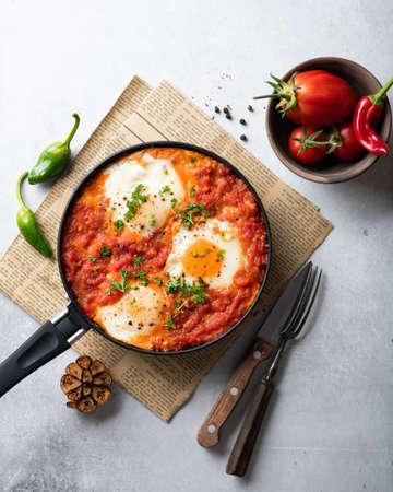 Shakshuka, fried eggs with vegetables in a frying pan, traditional israeli cuisine, top view Reklamní fotografie