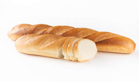 two wheat sliced baguettes on a white background