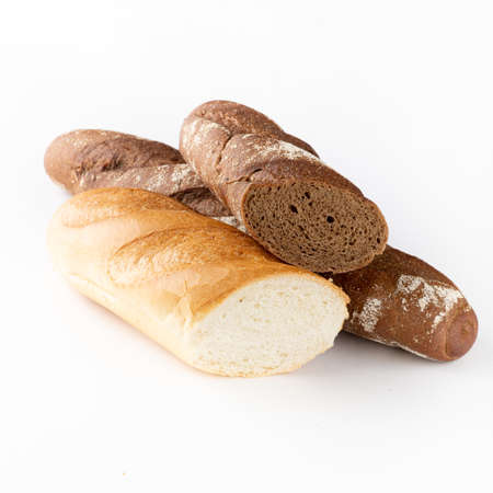 sliced rye and wheat baguettes on a white background Reklamní fotografie