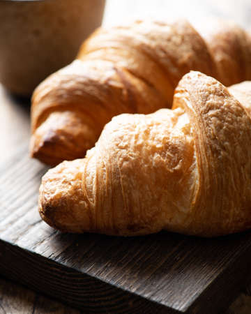 croissant on a wooden board, selective focus, close-up