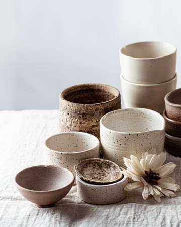 handmade ceramic tableware on light linen background