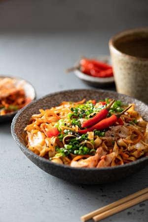 Asian food, wok noodle and vegetables in ceramic bowl, selective focus Reklamní fotografie