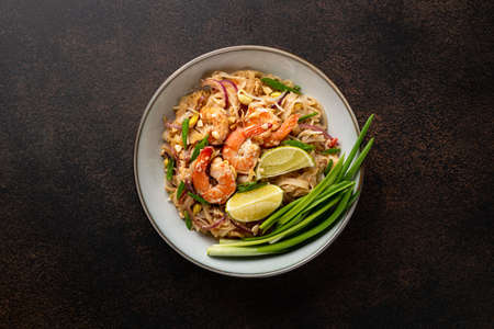 Traditional dish Pad Thai with shrimp on a dark background, top view Reklamní fotografie