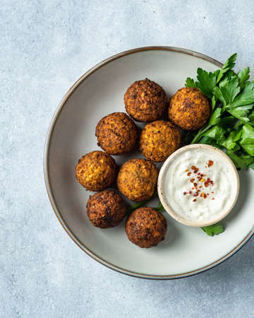 falafel with sauce on a blue background, view from above, selective focus Reklamní fotografie