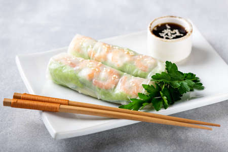 Spring rolls with shrimp, carrots, cucumber, green onions and rice noodles, selective focus