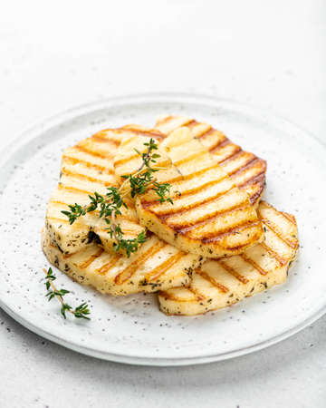 grilled halloumi cheese on a white ceramic plate, selective focus Reklamní fotografie