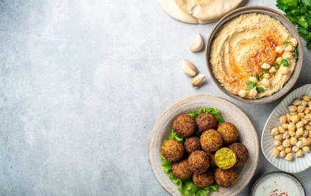 Chickpea dishes, falafel and hummus, on a concrete background, top view, copy space Reklamní fotografie