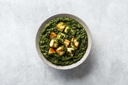 Indian Palak Paneer on concrete background, top view