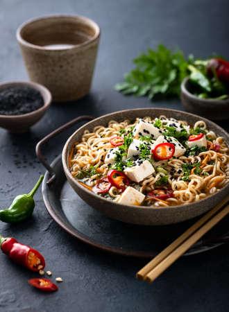 Asian vegetarian food, ramen with tofu and vegetables on dark background, selective focus Reklamní fotografie