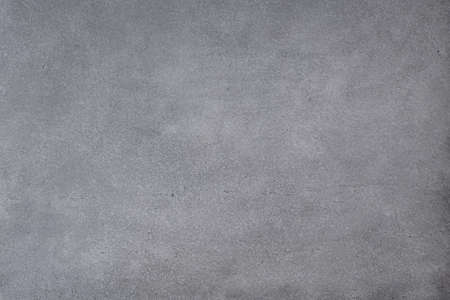 Gray concrete wall background with texture and scuffs