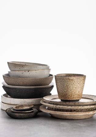 handmade ceramics, empty craft ceramic plates and bowls on light background Reklamní fotografie
