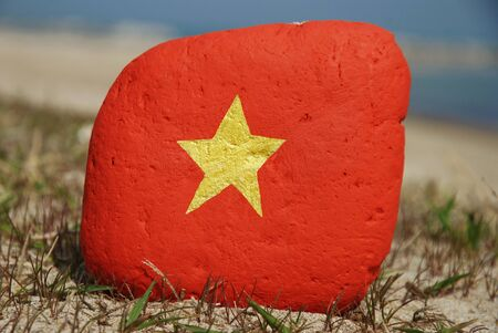 flag colours of Vietnam over a stone on the rocks Stock Photo - 12878831