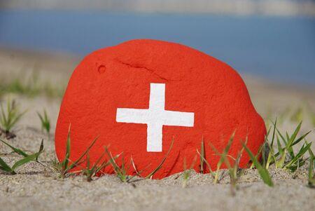Switzerland flag painted on a stone