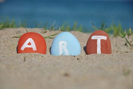 art word painted on three pebbles Stock Photo - 13156779