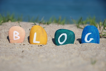 blog word and game with colourful pebbles