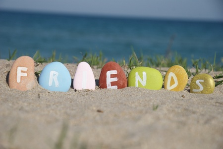 friends word on colourful pebbles over the sand Stock Photo