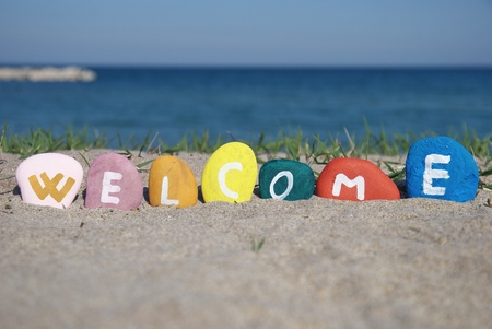welcome concept over the sand with sea background Stock Photo
