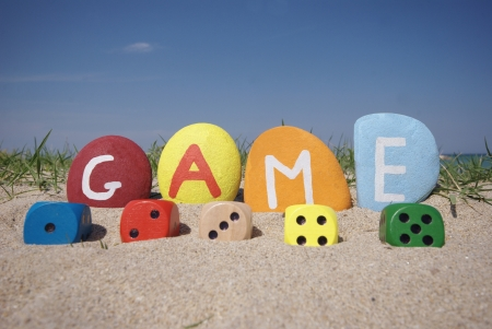 dices game concept with colourful stones on the sand Stock Photo - 13892577