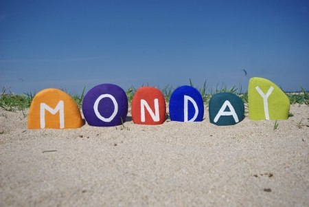 Monday, first day of the week on colourful stones Stock Photo