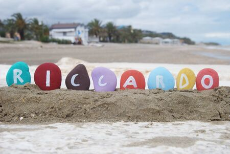 Riccardo, male name on colourful pebbles