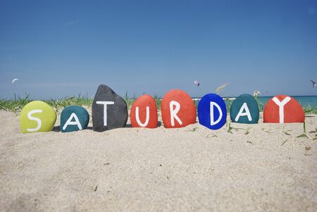 Saturday, sixth day of the week on colourful stones Stock Photo