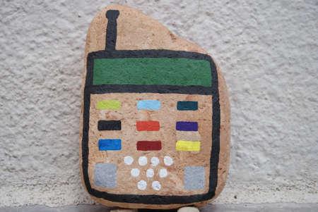 cep telefonu konsepti bir taş boyalı Stock Photo