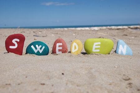 Sweden, word on colourful pebbles Stock Photo - 14128613