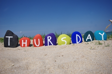 Thursday, fourth day of the week on colourful stones Stock Photo