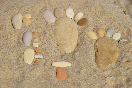 stone feet and stone word on the beach photo