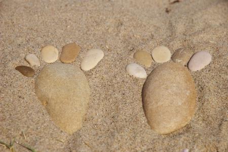 stone feet on the sand photo