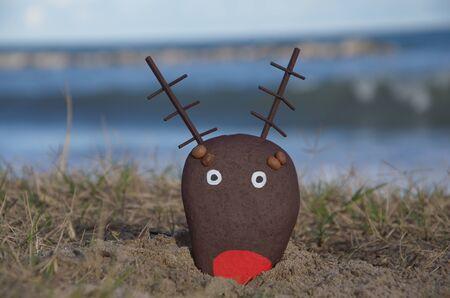 bir taş boyalı ren geyiği kafası, yılbaşı nesne Stock Photo