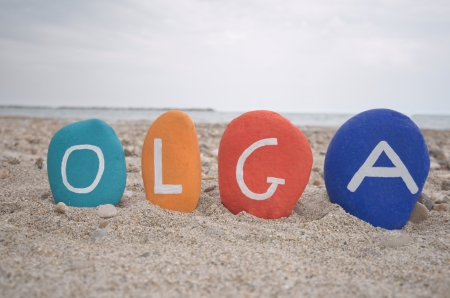 Olga, female name on colourful stones